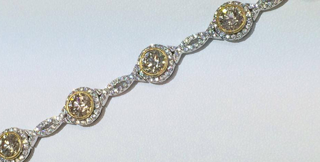 Custom Design Diamond Bracelet: 6.00 carat fancy yellow round diamonds set in 22k yellow gold bezel, accented with 2.00 carat round brilliant cut diamonds.