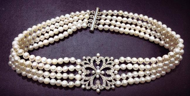 Custom made four strand cultured fresh water pearl choker style necklace.